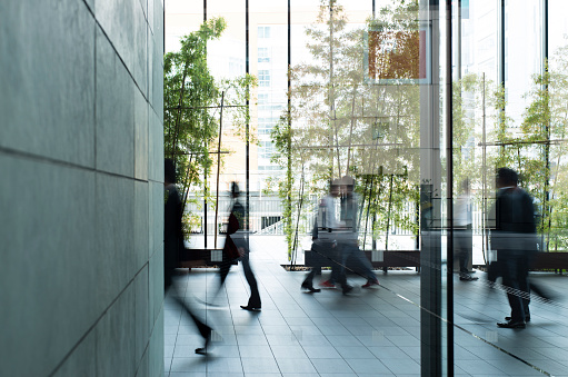 Business person walking in a urban building 488888801