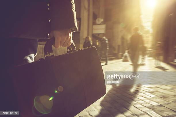 Business person walking with briefcase in Rome