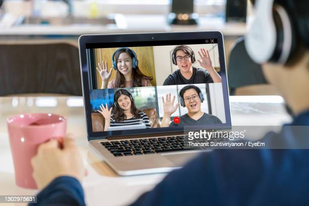 business persons talking on video conference - four people stock pictures, royalty-free photos & images