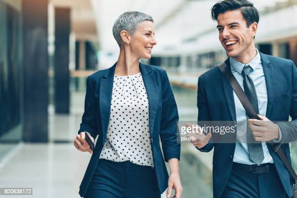 Business persons walking together