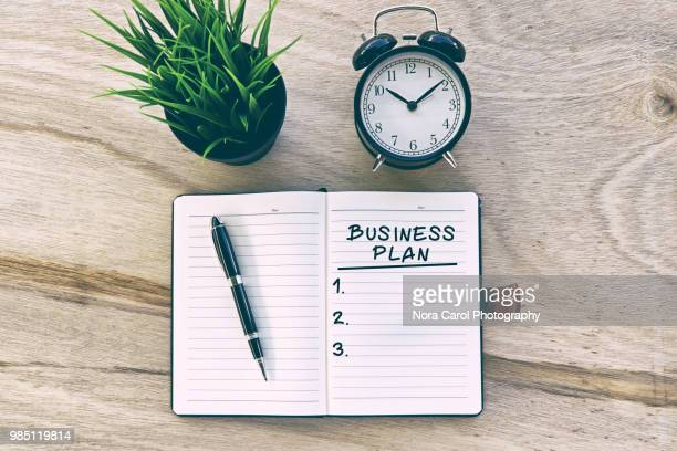 business plan on note pad - business plan stock pictures, royalty-free photos & images