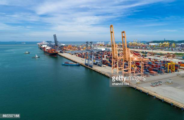 Business port with Ship for container with working crane bridge in shipyard for Logistic Import Export background in Thailand.