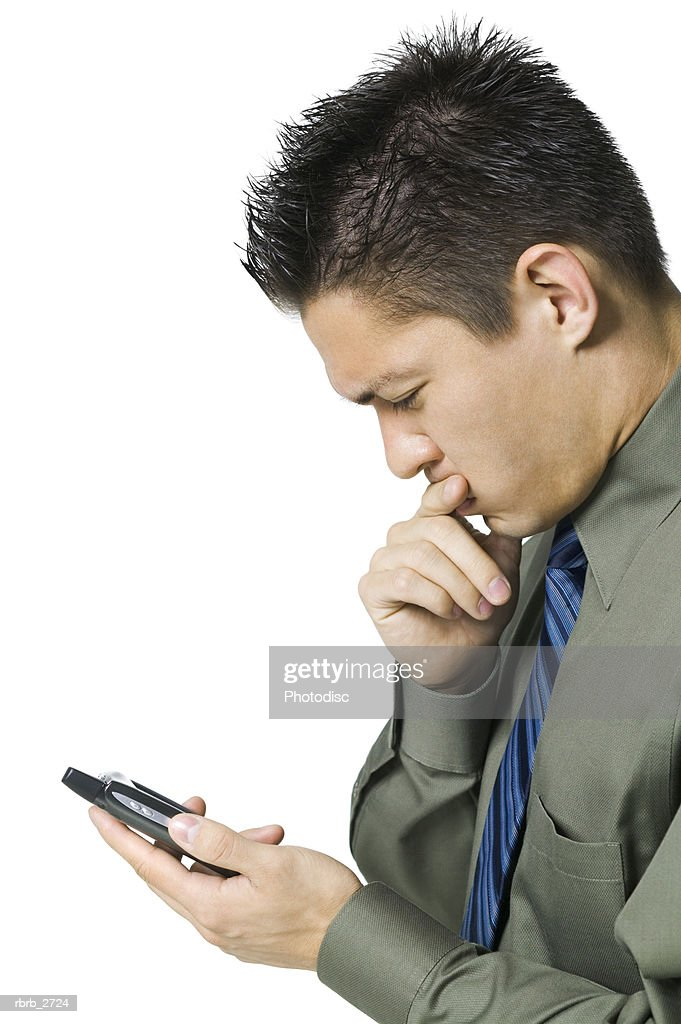 business portrait of an adult male in a green shirt as he looks at information on his pda : Stockfoto
