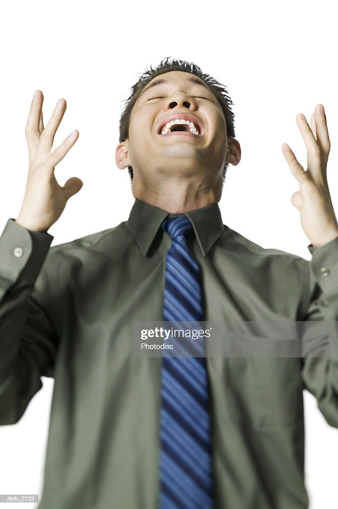 business portrait of an adult male in a green shirt as he throws up his arms in frustration : Foto de stock