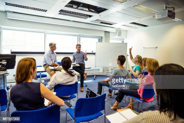 business presentation in progress - england stock pictures, royalty-free photos & images