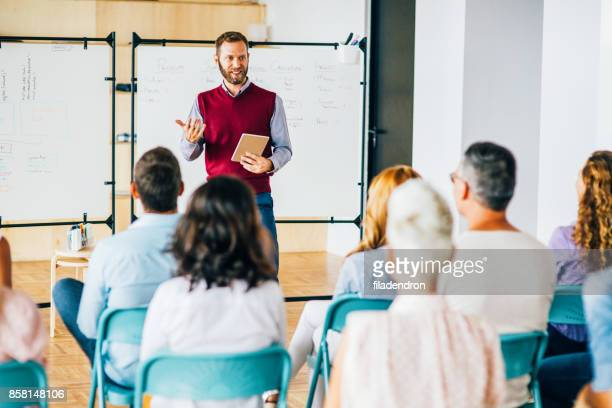 business presentation - public speaker stock pictures, royalty-free photos & images