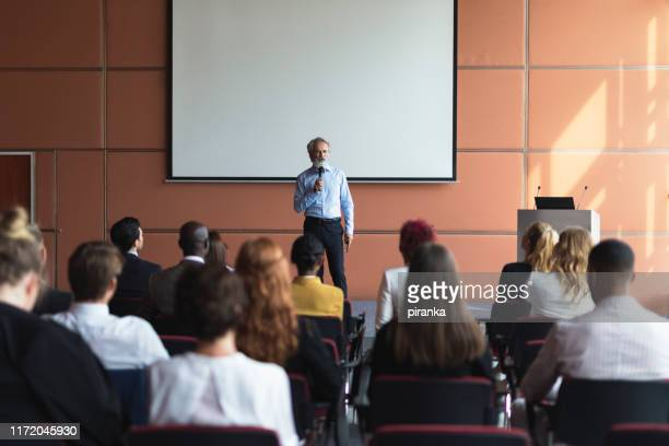 business presenter - presenter stock pictures, royalty-free photos & images