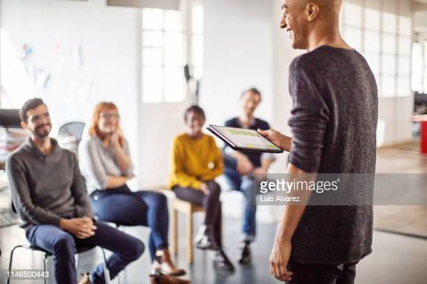 business professional leading a meeting - participant stock pictures, royalty-free photos & images