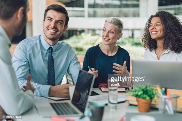 business professional talking to the senior management - vestuário de trabalho formal imagens e fotografias de stock