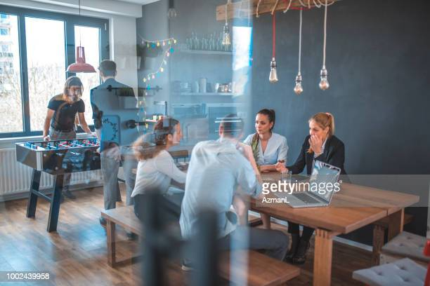 Business professionals at table in cafeteria