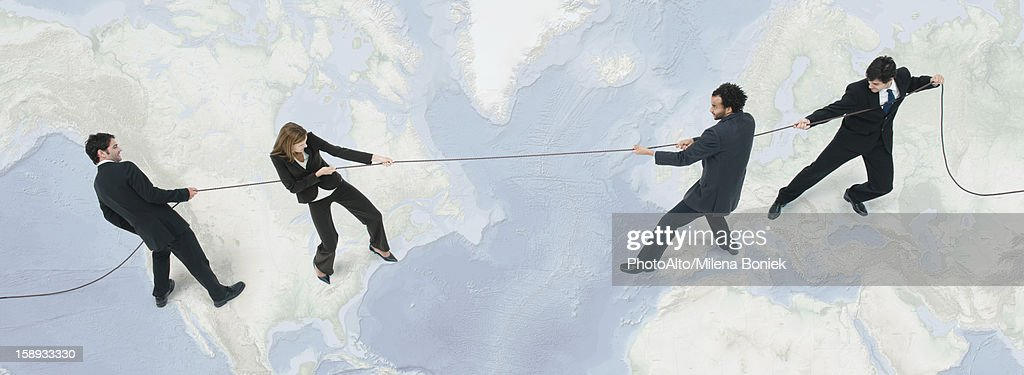 Business professionals compete globally for new business opportunities : Stock Photo