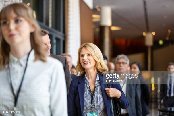 business professionals during a break at seminar - attending stock pictures, royalty-free photos & images