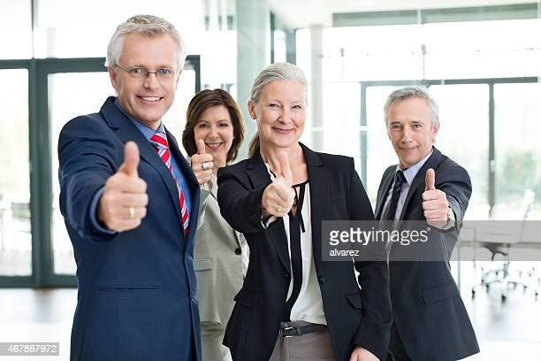 Business professionals wishing good luck