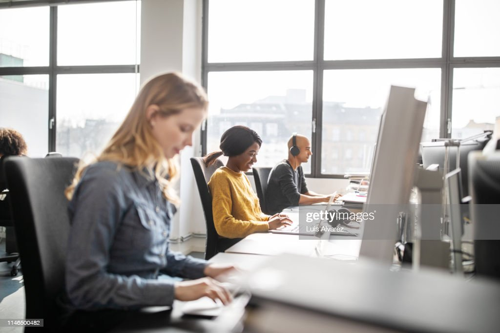 Business professionals working at their desks : Stock Photo