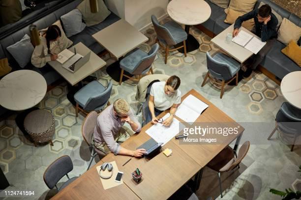 business professionals working in creative office - coworking stock-fotos und bilder