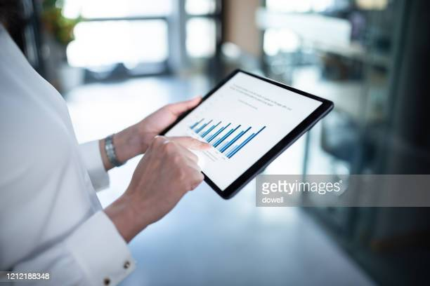 business report on digital tablet - business strategy stock pictures, royalty-free photos & images
