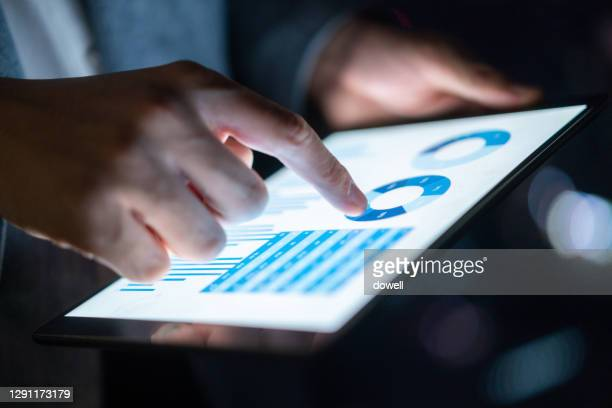 business report on digital tablet - making money stock pictures, royalty-free photos & images