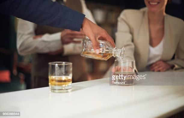 business retreats, drinking in the bar, happy hour. - bebida alcoólica imagens e fotografias de stock
