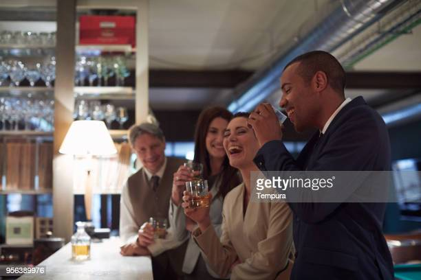 business retreats, drinking in the bar, happy hour. - happy hour stock pictures, royalty-free photos & images
