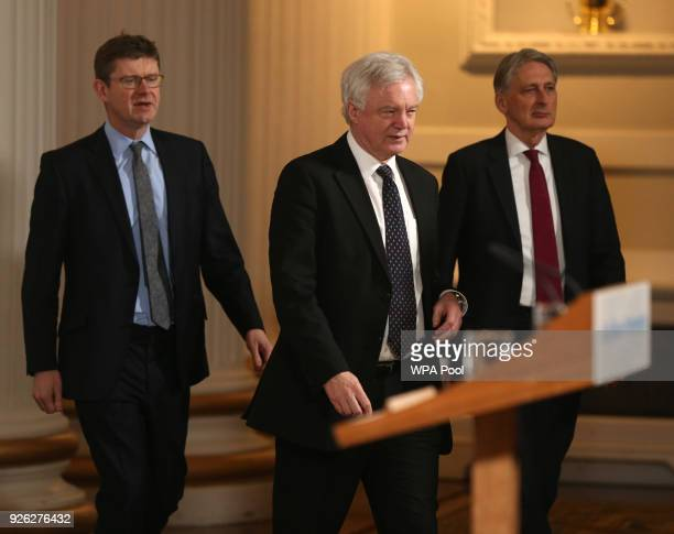 Business Secretary Greg Clark Brexit Secretary David Davis and Chancellor Philip Hammond arrive to listen to a speech by Prime Minister Theresa May...