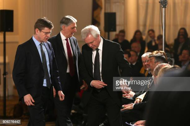 Business Secretary Greg Clark Chancellor Philip Hammond and Brexit Secretary David Davis arrive to listen to a speech by Prime Minister Theresa May...
