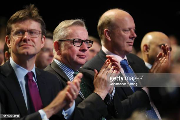 Business secretary Greg Clark Environment secretary Michael Gove and Transport secretary Chris Grayling applaud before British Prime Minister Theresa...