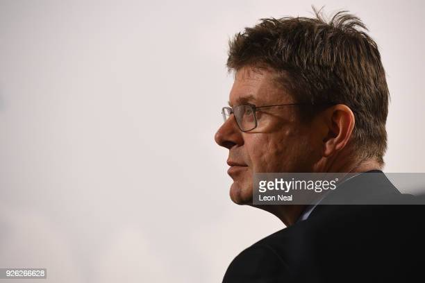 Business Secretary Greg Clark listens as British Prime Minister Theresa May delivers a speech at Mansion House on March 2 2018 in London England...