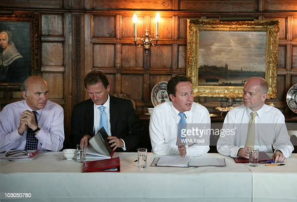 Business Secretary Vince Cable Cabinet Secretary Gus O'Donnell Prime Minister David Cameron and Foreign Secretary William Hague at Chequers the Prime...
