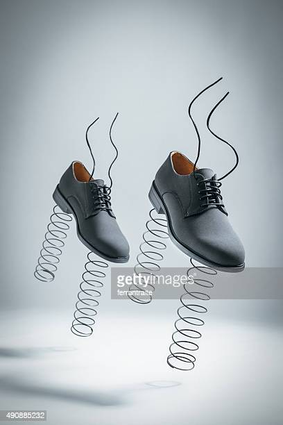 business shoes with springs jumping by themselves - taking off activity stock pictures, royalty-free photos & images