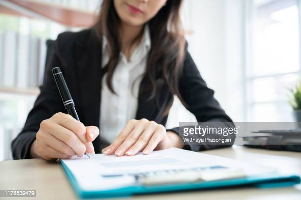 business signing a contract buy - agreement stock pictures, royalty-free photos & images