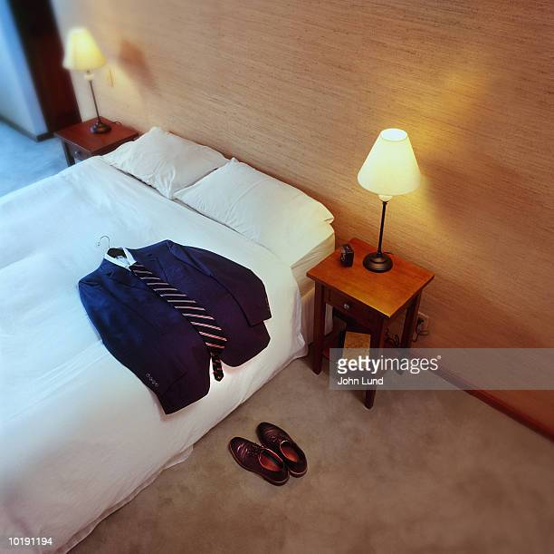 Business suit laid out on bed