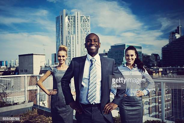 business superheroes standing outdoor on rooftop - hero stock photos and pictures