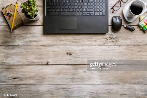business table top with office supplies on rustic wooden table - schreibtisch stock-fotos und bilder