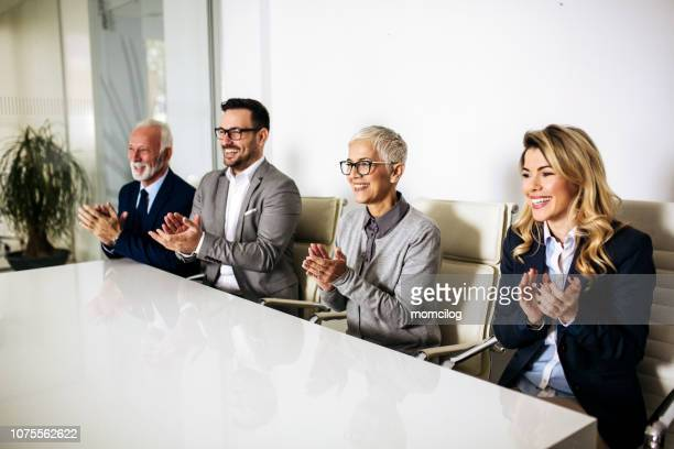 business team applauding in the office - employee appreciation stock pictures, royalty-free photos & images