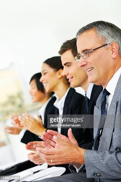 Equipa empresarial Aplaudir