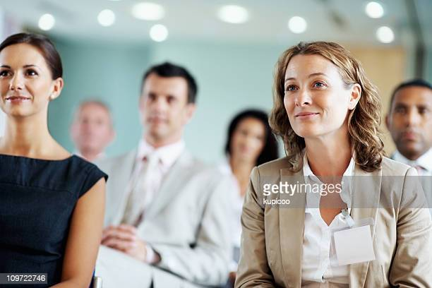 business team at a seminar - press conference stock pictures, royalty-free photos & images