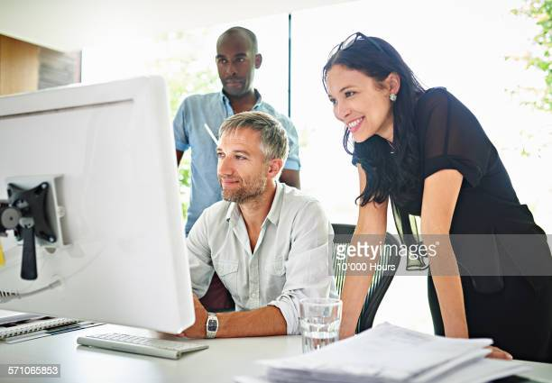 Business team at computer working on a project
