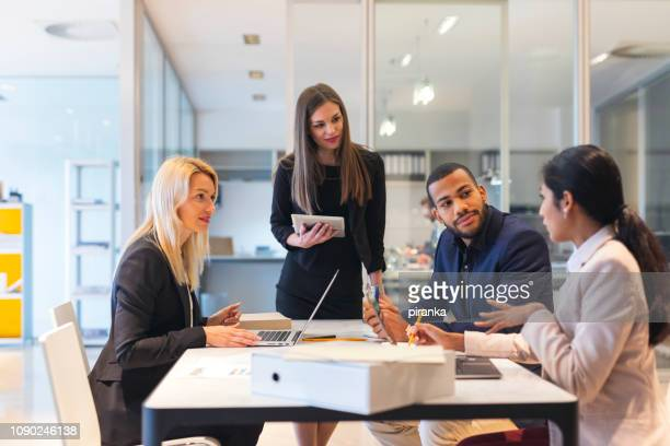 business team at work - four people stock pictures, royalty-free photos & images