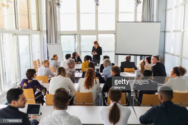 business team attending a meeting - attending stock pictures, royalty-free photos & images