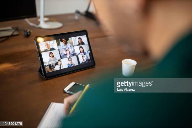 business team brainstorming ideas during online meeting - affichage digital photos et images de collection