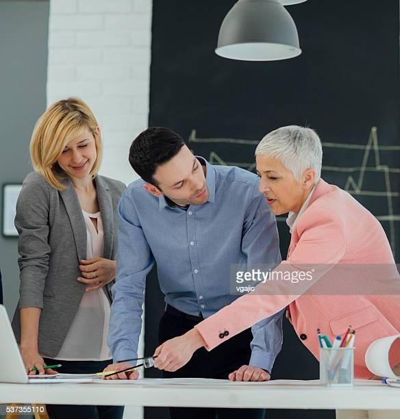 Business Team Brainstorming In Their Office.