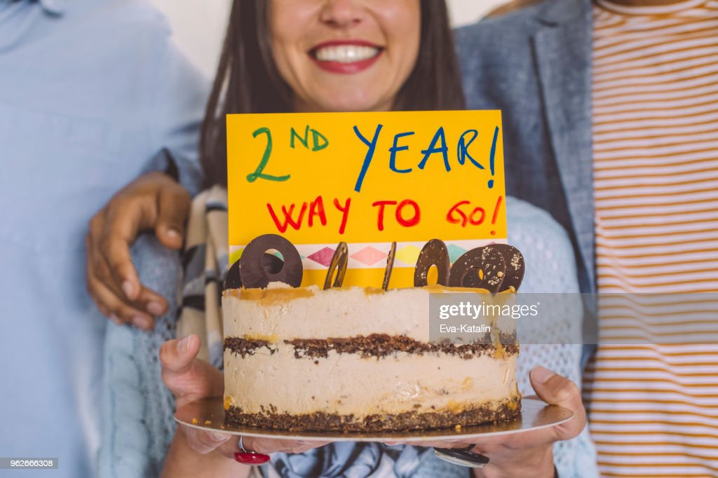 Business team celebrating their second year : Stock Photo