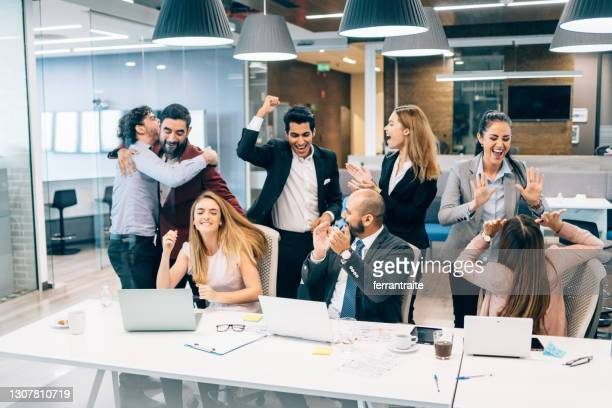 business team celebration - launch event stock pictures, royalty-free photos & images