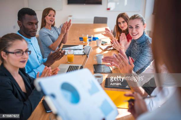 Business team clapping after great presentation