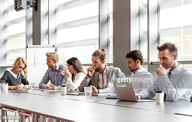 Business team collaborating in board room
