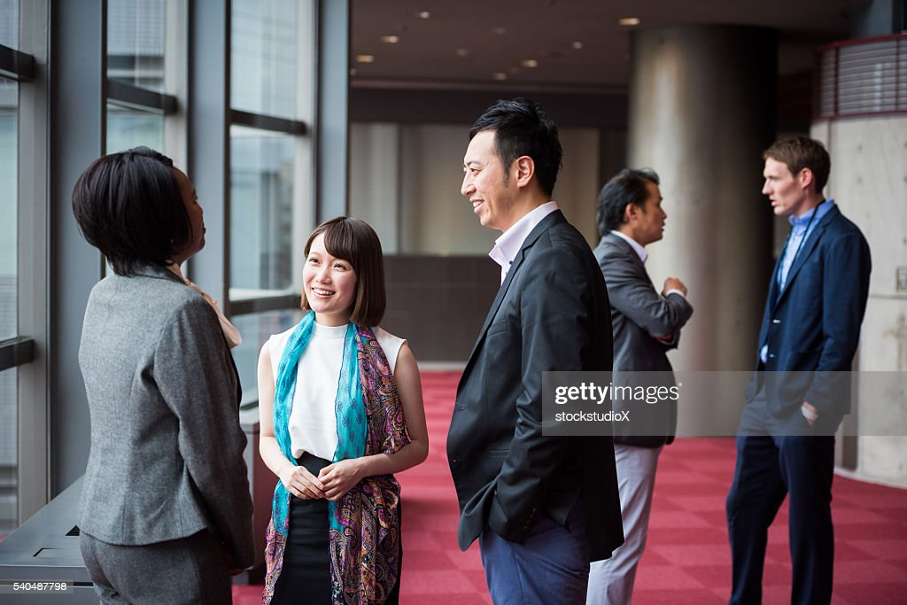 Business team consulting in the foyer at a conference : Stock Photo
