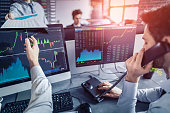 Business team deal on a stock exchange. Stock traders concept.