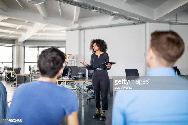 business team during a suggestion session in office - black pants stock pictures, royalty-free photos & images