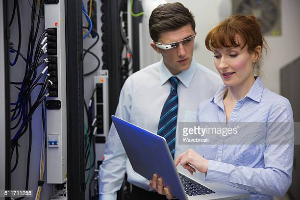 Business team fixing some servers