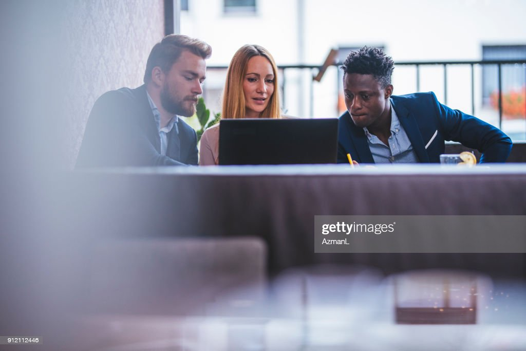 Business Team Having Meeting In A Coffee Shop High Res Stock